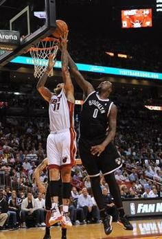 Mar 12, 2014; Miami, FL, USA; Miami Heat forward Chris Andersen (11) is pressured by Brooklyn Nets center Andray Blatche (0) during the seco...