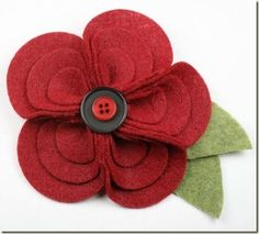 felt flower with button center - good as a brooch for mother's day or fun small gift (or to decorate lapels, hats, ballet flats, etc etc).