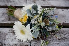 this bouquet is so pretty i dont even mind the gerbera daisys. Thistle, delphinium, scabiosa pods, fiddle head fern, pussy willow!