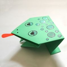 Make simple origami jumping frogs in just a few steps - good craft for kids.