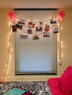 Can't hang curtains? Try this cool way to display pictures and light up your dorm! You can also use white cord lights or colored.
