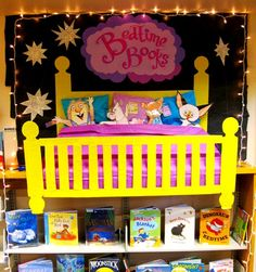 "This adorable ""Bedtime Books"" library display by Rachel Moani  is great for showcasing books that parents and children would enjoy reading together at bedtime."