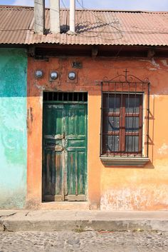 Antigua is full of beautiful brightly painted buildings and doors. Some are newly repaired, some are decaying. Both are charming.    Follow our journey around the world at To Uncertainty & Beyond.     -    Travel Guatemala
