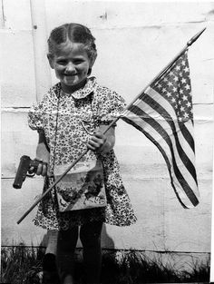 Girl with flag and gun, 1952