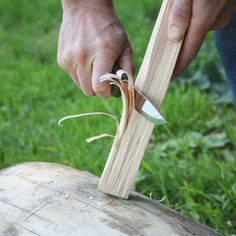 making feather sticks for the camp fire
