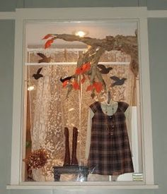 fall window #display + boots on table