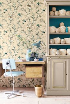 Little Greene Great Ormond St is a late 19th century wallpaper design with colourful parrots in swaying branches.
