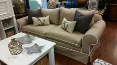 Sofa with a trim to POP! This was just upholstered in a linen cotton blend fabric that gives  a slipcover relaxed look to any decor. TCC $799.99