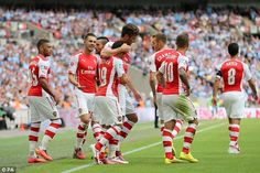 Hugging the little man: Cazorla is embraced by Giroud after the Frenchman's 60th minute go...