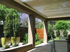 Rendered Columns and Bulkheads with louvre roof verandah adjacent dwelling and garden