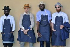 Denim aprons with shirts. The idea of a uniformed apron whilst allowing a level of individuality with their own smart shirts.