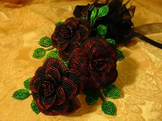 french beaded wire roses, I love the way these look, but I'd rather stitch, wire wrapping is tedious to my way of thinking. Beaded by Brian Wycoff