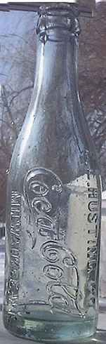 The E.L. Husting  with vertical Coca Cola. The only Coke bottle vertically embossed.