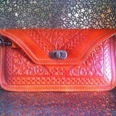 For orange lovers this handmade leather clutch is for you... More colors are available. Visit moroccancorridor.com to explore the entire collection. .