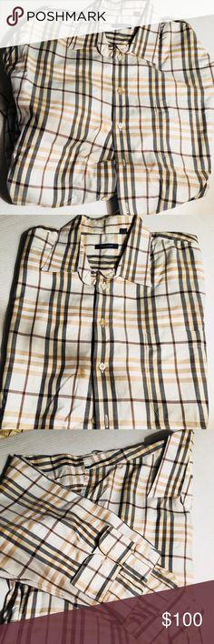 Burberry Men's button down dress shirt Burberry Men's button down dress shirt 1 small stain at 3rd button Dry cleaned only Burberry Shirts Dress Shirts