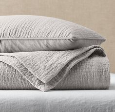 RH's Vintage-Washed Linen Channel-Quilted Coverlet:FREE SHIPPINGOur linen bedding is tailored with rows of channel stitching for understated style and a lightly quilted finish. Pre-washing gives the linen a relaxed, lived-in softness, and the touch only gets softer with each laundering.