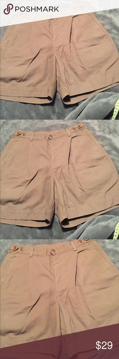 "Men's Dockers Brown Shorts w/ Pleats Men's Brown Cargo Shorts.                   Zipper & Button Closer.   4 Pockets.              Buttons at Waist to let sides out 1"" on each side.    Dockers.  Length--18"".       Waist--16"".  Stretch in Sides and again 1"" release button on each side.    NWOT.  Never Worn. Dockers Shorts Cargo"