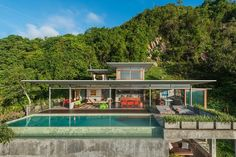 Built by architect and photographer Mark Gerritson, The Naked House is a stunning six-bedroom minimalist house on the Thai island on Koh Samui with concrete floors and plenty of outdoor space.