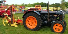 Fordson Standard N tractor with attached horse drawn type mowing machine. This was very common as tractors replaced horses.