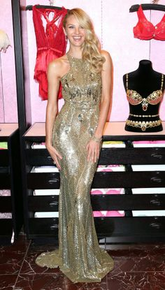 Best Dressed, Glitz and Glamour: Candice Swanepoel by The Fashion Beast Team Angel Candice Swanepoel almost upstaged the $10 million Royal Fantasy Bra when she donned a gold beaded and sequined gown from Zuhair Murad's Resort 2014 collection at the Victoria's Secret store in Herald Square on November 6.