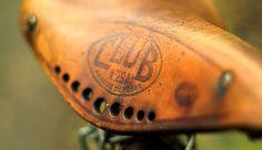saddle; old leather bike seat, too.