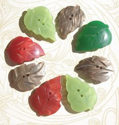 A group of 8 vintage buttons from the 1930s shaped as leaves. These would make lovely embellishments on a quilt, wall hanging, button jewelry piece