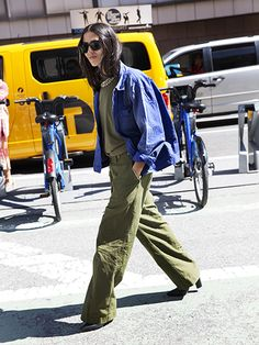 NYFW Street Style Spring 2016 - Gilda Ambrosio's army green cargo pants, T-shirt and denim shirt with sunglasses, heels and a collar necklace | allure.com