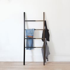 Buy Hub Ladder from Umbra. Our adjustable organizational ladder makes a stylish hanging rack for clothes, linens, and accessories for a functional and d. Hanging Clothes Racks, Hanging Racks, Spring Cleaning Organization, Storage Organization, Ladder Bookcase, Modern House Design, Interiores Design, Ladder Decor, Bathroom Fixtures