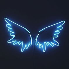 A neon version of Karou's angel wing art school project, in her signature blue.