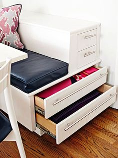 Keep table linens at the ready with shallow drawers under a banquette seat. Pullout drawers are easier to access than flipping up the seat, upsetting cushions, pillows, and even diners.