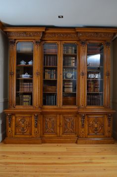 Over-the-top carvings on this bookcase (fiction) Extra bookcase in Elliott's Law Office in Stillwater Springs. X