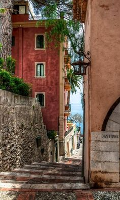 Sicily's legendary resort town of Taormina ~ has twisting medieval streets and the Ionian Sea in the background in Italy.