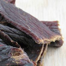 Smoky Honey Glazed Beef Jerky Ingredients: 2 1/2 pounds of beef 3 garlic cloves finely minced 1 cup of soy sauce 3/4 cup of honey 1 teaspoon black pepper 1/2 teaspoon salt 1 teaspoon of liquid smoke 5 tablespoons of freshly squeezed lemon juice