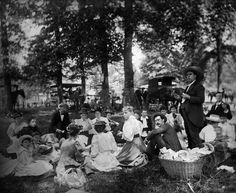 Group Having Picnic In Woods With Horses and Wagons In Background, 1895