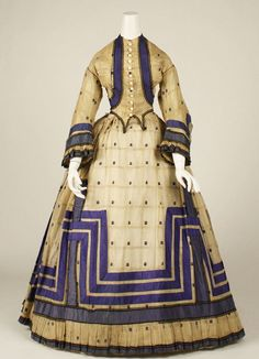 1863 ensemble Great use of ribbon and pleating to add drama to this lovely dress.