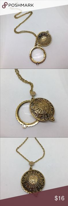 """Gold Filigree Magnifying Glass Necklace A 1 1/2"""" in diameter gold filigree pendant strung on a 26"""" adjustable chain, with a magnifying glass that slides out from beneath the pendant. Similar to the pendants worn in the Drawing Room in the Edwardian era. Use it to read those tiny words without the hassle of reading glasses.  Jewelry Necklaces"""