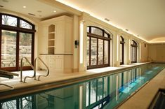 long indoor pool ceiling lights big glass windows white ceiling cabinet shelf door modern lamps of Indoor Pool House to be Greatly Inspired By