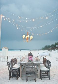 A gorgeously light table on the beach.