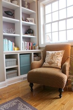 The perfect reading space. Comfy chair, close to shelves, lots of light.