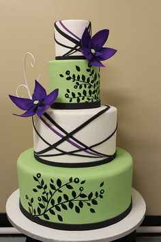 green and purple modern wedding cake w/o