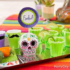 Tequila time! Love these fun fiesta shot glasses and DIY sign on a sugar-skull balloon weight!