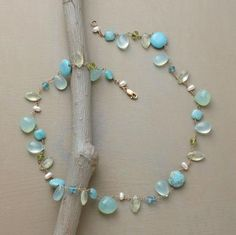 """betwixt & between necklace    Soothing blue-green hues in a variety of shapes and sizes, wired to lie any which way. Peruvian chalcedony, prehnite, turquoise, amazonite and cultured pearls on 14kt gold wire. Lobster clasp. Exclusive. A handmade Anne Sportun original. Approx. 16""""L."""