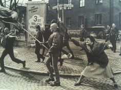 A woman hitting a skinhead with her handbag, Sweden, 1985. The woman was reportedly a concentration camp survivor.