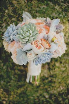 Beautiful Wedding Bouquet In Muted Tones Of: Peach English Garden Roses & Ranunculus, Peach Hydrangea, Green & Green/Gray Succulent, & Broad Leaf Dusty Miller, Hand Tied With Ivory Satin Ribbon.....