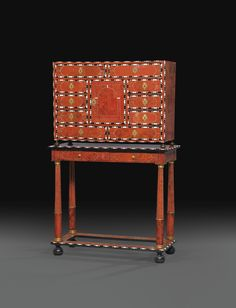 A FLEMISH RED TORTOISESHELL, EBONY AND IVORY MARQUETERY CABINET, CIRCA 1710, ON A STAND OF LATER DATE  Height 65 3/4 in; width 41 1/4 in, depth 17 3/4 in