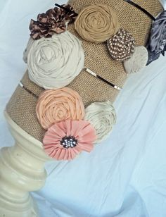 Headband holder-oatmeal container covered in burlap & placed on a candle holder