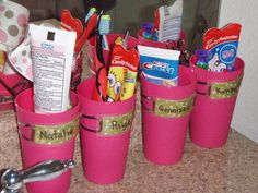 Toothbrush & Paste organizing for a lot of kids.  Keeps germs off! Name tags on each cup.