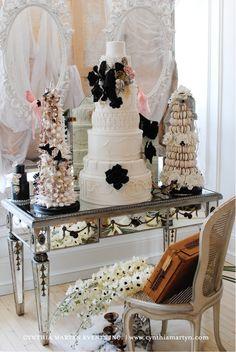 Stunning wedding cake with black flowers and macaron tower.