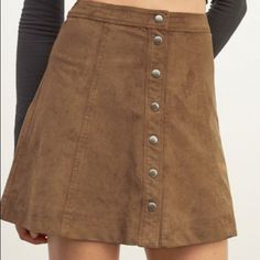 Abercrombie & Fitch Faux Suede Skirt Color is camel/brown. Retails currently for $58. Worn only maybe once! Super cute and adorable just decided I wanted corduroy.  waist fits about 26-27 inches. Fits exactly like the model. The buttons are snaps, and they have the perfect amount of resistance to them so they don't unbutton randomly! A-line style! Abercrombie & Fitch Skirts A-Line or Full