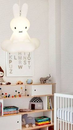 Perfect baby room setup for those that opt to keep their child's gender a surprise. We love the playfulness of the rabbit light and the bookcase filled with colorful children's toys. The mix of whites help keep this newborn's room gender neutral.
